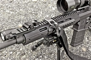 The rifle's proprietary handguard is highly customizable through bolton Picatinny rail sections and grip panels. A Magpul RSA sling mount and MS3 sling are pictured.