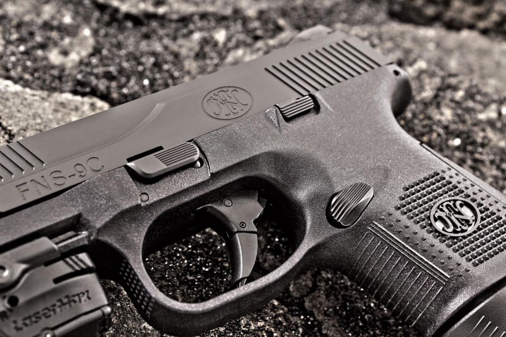 Controls are large and heavily serrated, and the trigger reach is comfortable on the FNS-9C.