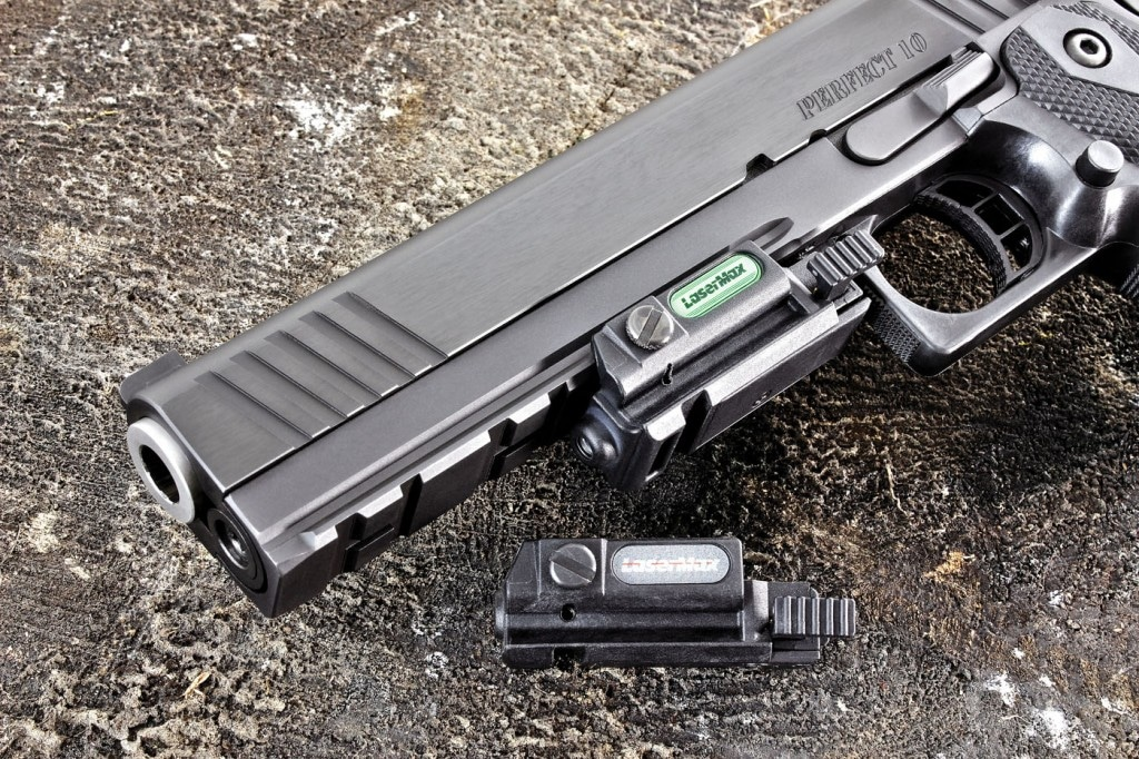 A full length accessory rail adds to the pistol's menacing look. Shown here are the green and I.R. Unimax lasers from LaserMax.