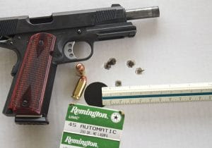 """Firing a double-tap of 230-gr. hardball, the all-steel and supremely ergonomic Rock River 1911 proved exceedingly controllable under recoil, allowing the shooter to get back on target quickly and consistently. The Tactical model's best 25-yard group came with inexpensive 230-gr. Remington UMC full-metal jacket ammunition. All five spanned just 1.60"""", and the best three grouped at 1.15""""."""