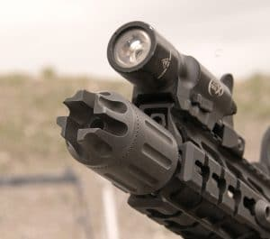 The lightweight CQB muzzle device fitted to the MK107 was designed for short-barreled rifles to deflect blast forward. It does its job well.