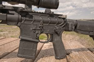 Receivers are forged—the left side of the low er housing an ambi magazine release.